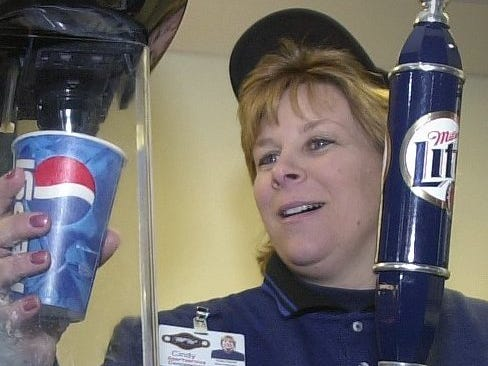 Cindy Kriefall, Miller Park concession manager, at work at Miller Park's open house Sunday, March 25, 2001.