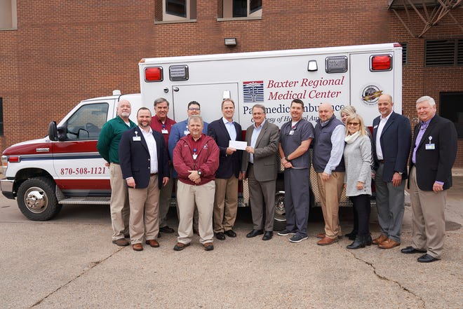 The Ernest and Anna Ritter Family Endowment recently presented Baxter Regional Hospital Foundation a $50,000 grant. Pictured are: (from left)Christopher Fry, EMT-P, Supervisor, Baxter Regional Ambulance Services; Justin Woods, CFRE, Gift Officer, Baxter Regional Hospital Foundation; Gerald Cantrell, RN, EMT-P, Director, Baxter Regional Ambulance Services; David Fox, BRMC VP/Chief Operating Officer; Steve Herron, EMT-P, Baxter Regional Ambulance Services; Ron Peterson, BRMC President & CEO; Ritter Arnold, Executive VP, E. Ritter & Co.; Dr. Brad Schulz, Cline Emergency Center and Medical Director, Community Paramedics/Baxter Regional Ambulance Services; Bo Phillips, Director of Sales –Hosted and Virtual Services, Ritter Communications; Paula Harris, Business Sales, Ritter Communications; Margaret Holloway, VP Community Public Relations/Community Development, E. Ritter & Co.; Scott Roberson, Business Sales, Ritter Communications; and Barney Larry, BRMC VP/Business Development and Executive Director, Baxter Regional Hospital Foundation.