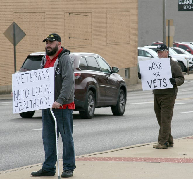 Disabled veteran Addison Isaacs and retired veteran Ronnie Young received honks of support on Thursday. Area veterans stood outside of the Mountain Home Plaza 2000 Veteran's Memorial protesting the limited services offered at the Mountain Home Veterans Administration CBOC (Community-Based Outpatients Clinic).