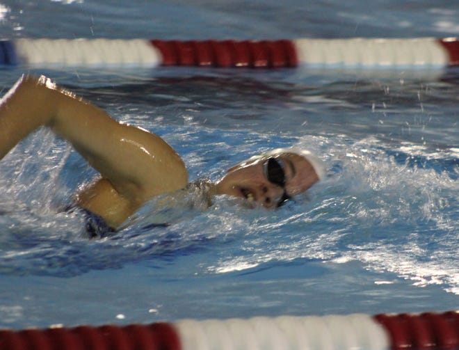Mountain Home's Madelyn Lynch competes in a freestyle event during a meet earlier this season. Lynch broke a six-year-old school backstroke record on Saturday at Batesville.
