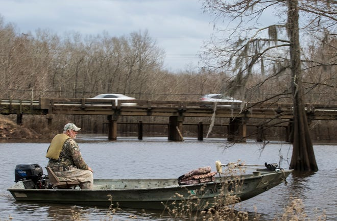 A man boats on Cheniere Lake on Jan. 22, 2019.