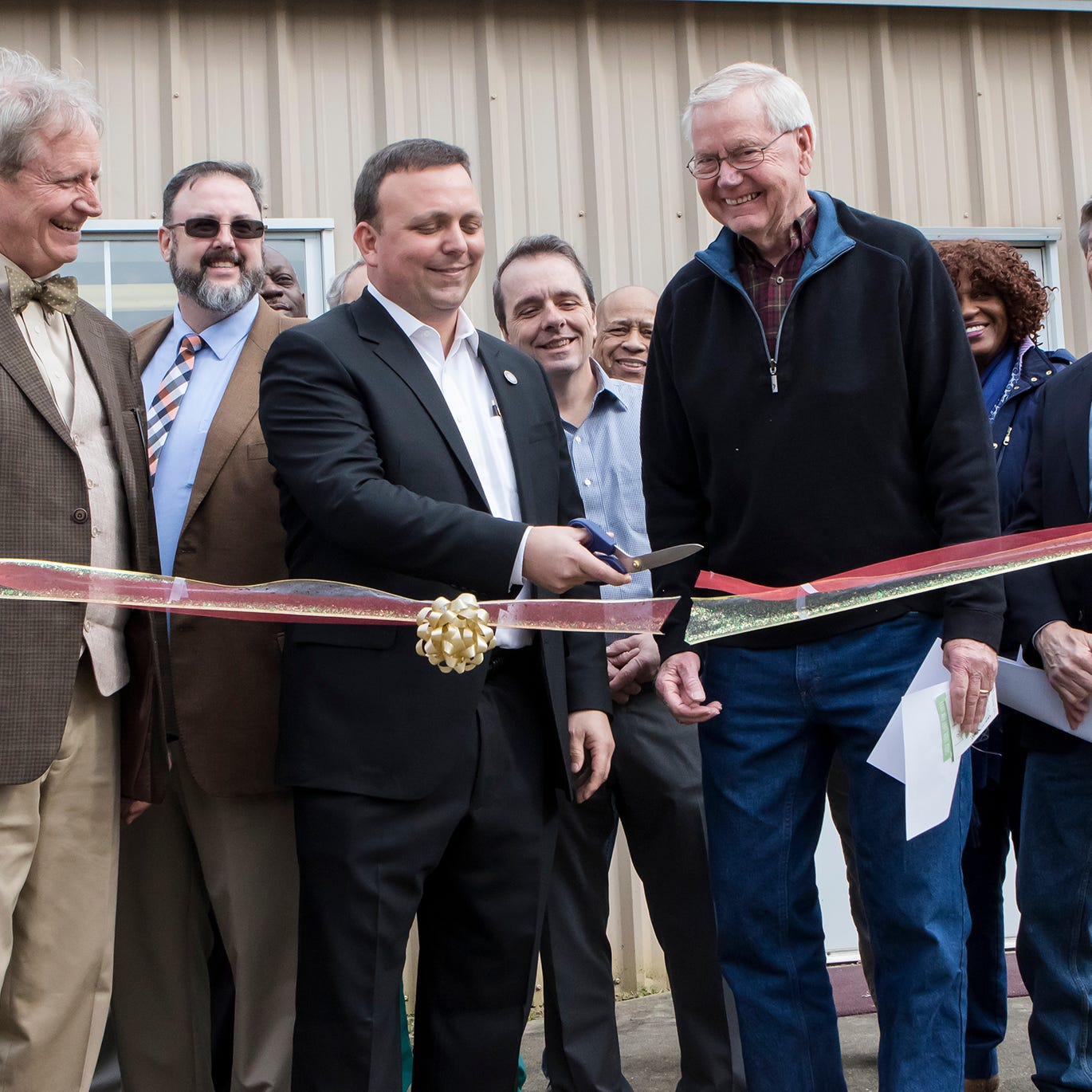 Jon Tellifero, left, City Council Member Michael Echols and    State Rep Frank Hoffmman (R- West Monroe) cut the ribbon on the new DeSard St. Shelter building, formerly, The Rose of Sharon Baptist Church, in Monroe, La. on Jan. 22. The shelter was recently able to purchase property belonging to the former church in order to expand so it may help more people in need.