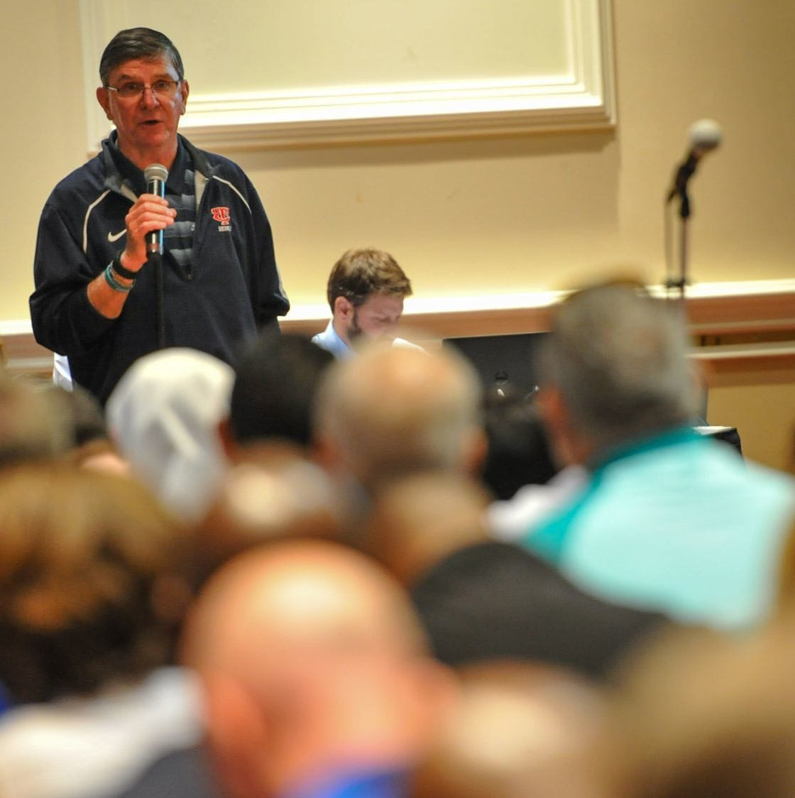 Teurlings Catholic principal Mike Boyer (speaking) authored a proposal that