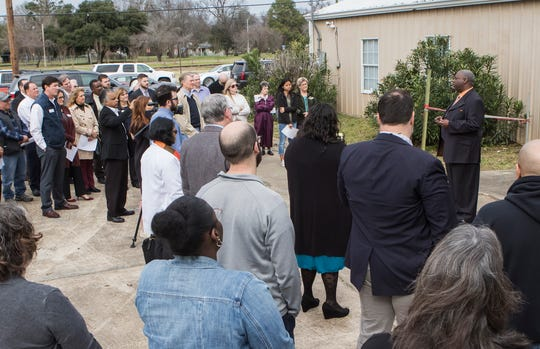 Billy Varner, director of the DeSard St. Shelter, addresses the crowd in front of The Rose of Sharon Baptist Church in Monroe, La. on Jan. 22. he shelter was recently able to purchase property belonging to the former church in order to expand so it may help more people in need.