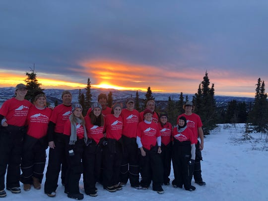 Watching the sunset in Alaska are Spencer Daniel, Pattie Daniel, Ron Mason, Cindy Mason, Olivia Mason, Patrick Daniel, Paige Mason, Brent Mason, Faye Wade, Andy Danna, Maria Danna, Martha Alexander and Blake Daniel.
