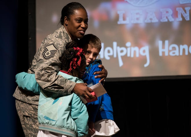 Master Sgt. Shantell Word-Duncan hugs Ryan Jackson and Saniyah Word-Duncan during the Super Citizens Celebration at the Davis Theatre in Montgomery, Ala., on Tuesday, Jan. 22, 2019. Nearly 800 students from eight schools gathered to honor everyday heroes in their schools.