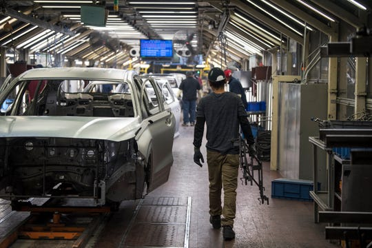 Workers assemble vehicles in the weld shop at the Hyundai plant in Montgomery, Ala., on Friday, Jan. 18, 2019.
