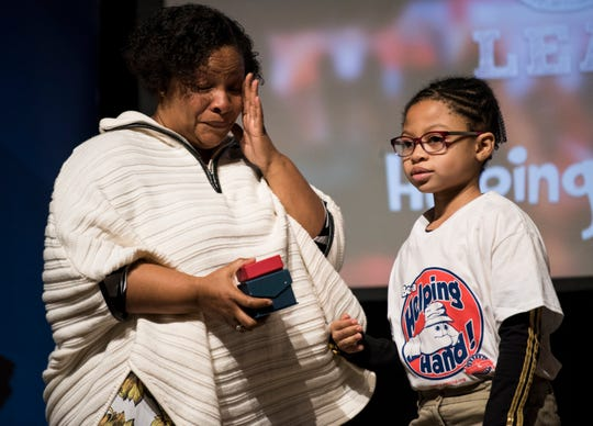 Yolanda Mosley is honored by Cydnei Urquhart during the Super Citizens Celebration at the Davis Theatre in Montgomery, Ala., on Tuesday, Jan. 22, 2019. Nearly 800 students from eight schools gathered to honor everyday heroes in their schools.