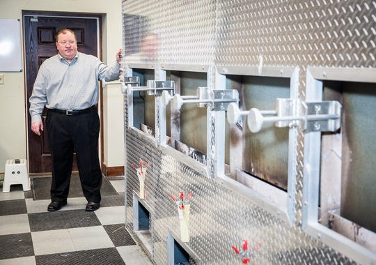 Rob Loose of Loose Funeral Home stands near the Loyal & True Cremation Pet Services' private animal cremation chambers. The funeral home offers communal and private cremations for pets.