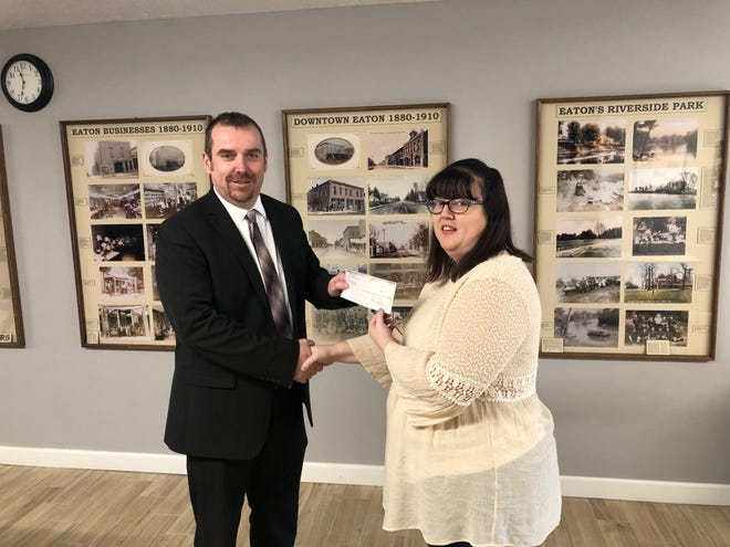Aaron Walter from Barnum Brown Insurance presents an IPEP Safety Grant to Bridgett Dewees from the town of Eaton.