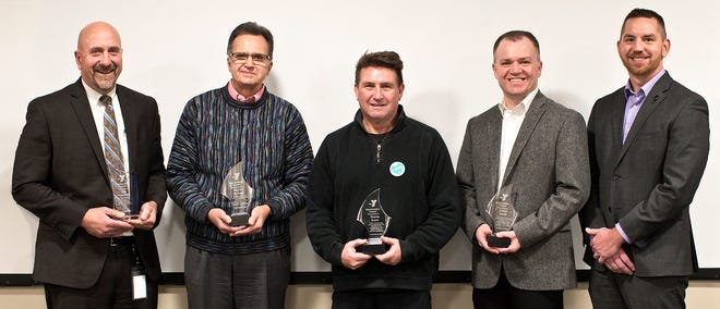 Five members of the YMCA of Muncie's Board of Director were honored for their service to the YMCA and the community.