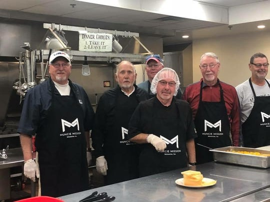 Volunteers with the Muncie Elks help serve lunch to volunteers that helped with a project for the Muncie Mission.
