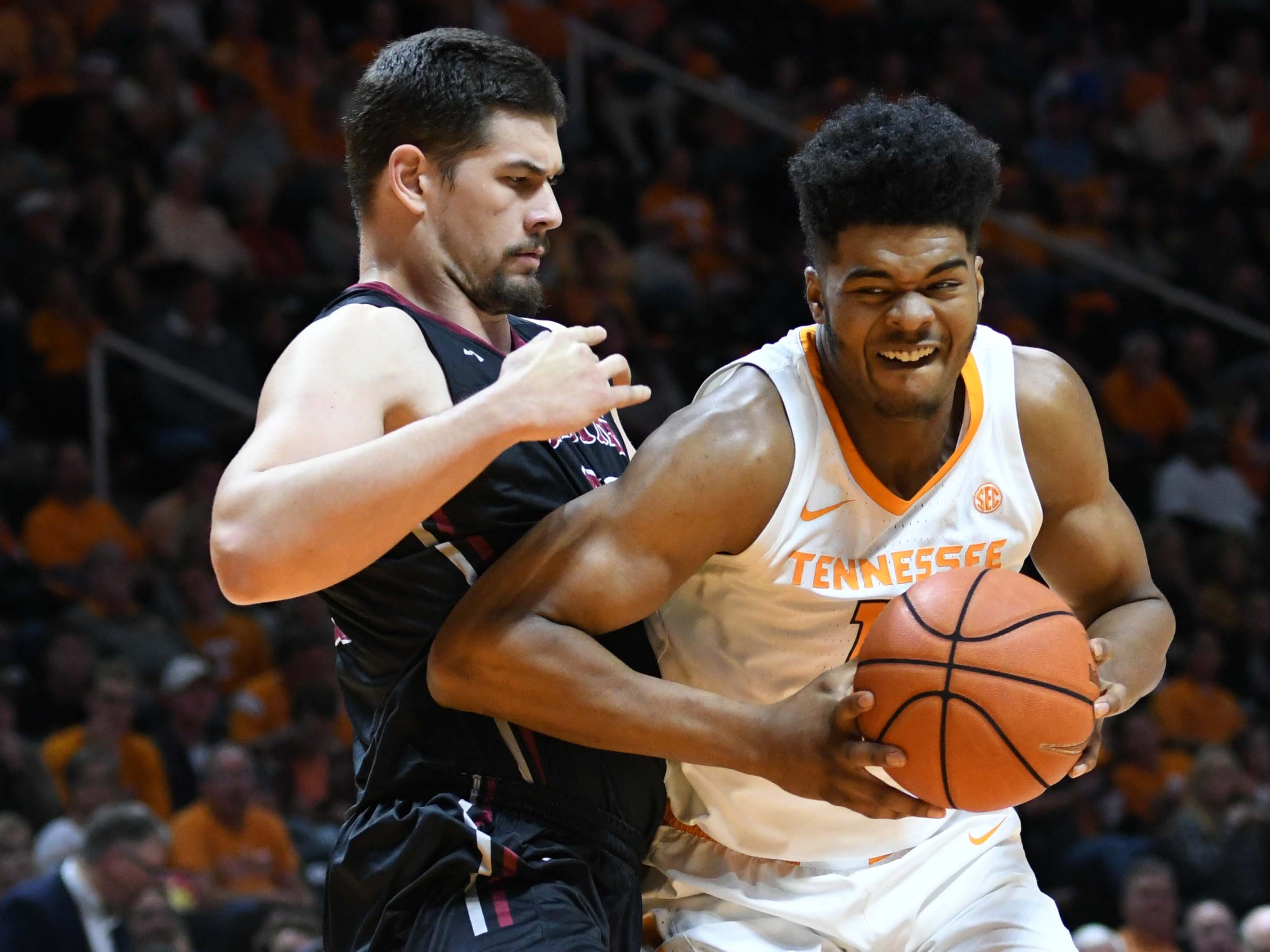Tennessee Volunteers forward Derrick Walker (15) moves the ball against Lenoir-Rhyne Bears Filip Leskovar (11) during the second half at Thompson-Boling Arena.