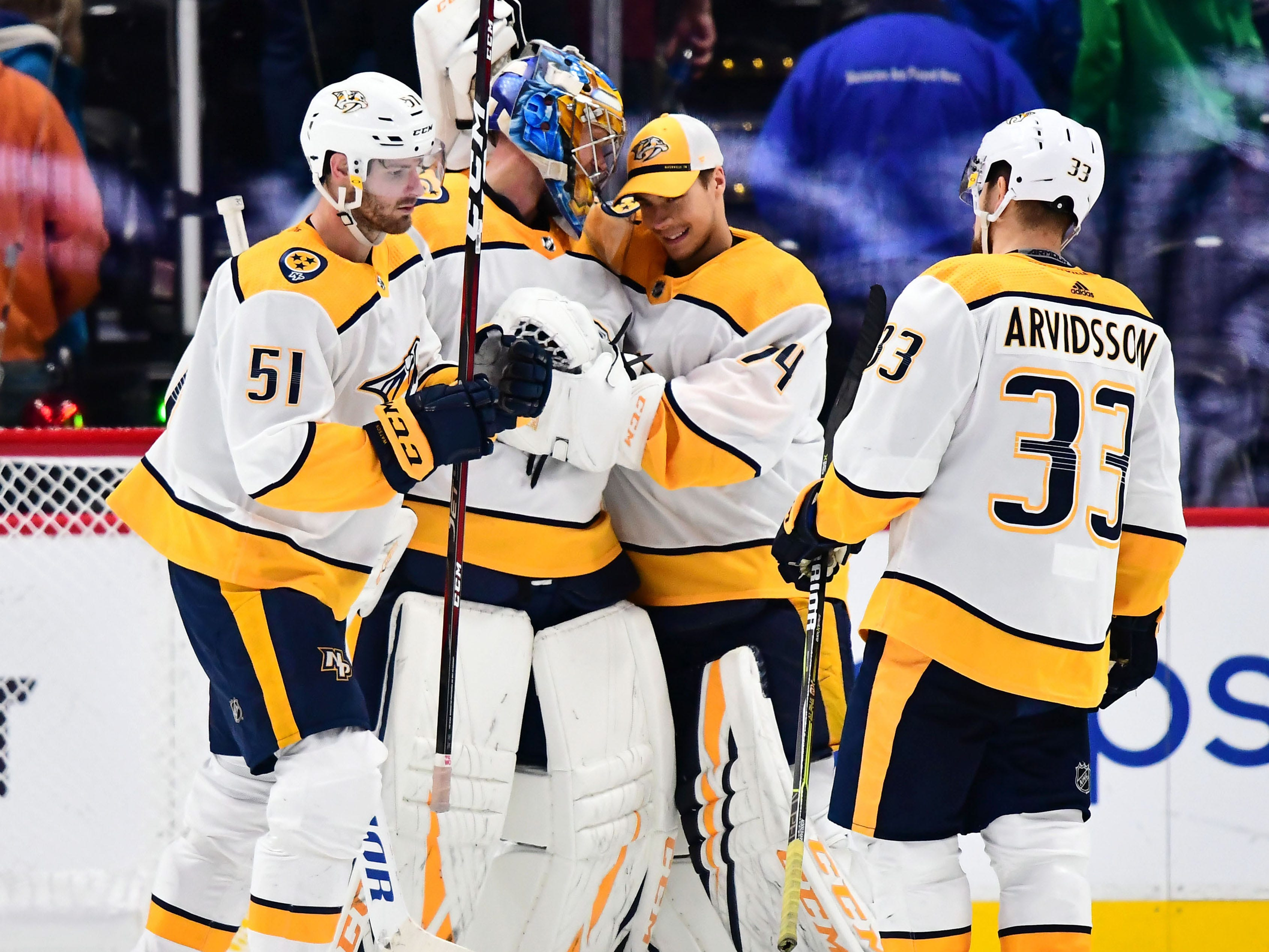 Nashville Predators left wing Austin Watson (51) goaltender Pekka Rinne (35) goaltender Juuse Saros (74) and right wing Viktor Arvidsson (33) celebrate the win over the Colorado Avalanche at the Pepsi Center.