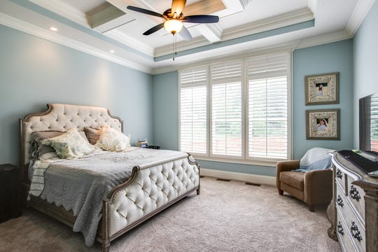 Homeowners should reduce personal items throughout the home, including the master bedroom.