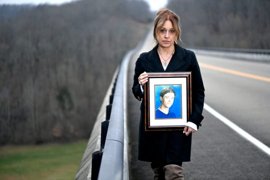 Trish Merelo holds a photograph of her son, John Miller, who died by suicide at the Natchez Trace Bridge in January 2016. Merelo is a co-founder of the Natchez Trace Bridge Barrier Coalition, a group created by survivors of suicide loss.