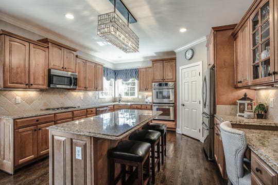 Realtor Lisa Culp Taylor worked with the Seems to remove all personal photos, clean closets and surfaces, organize the garage and even reconfigure the home's furniture — all resulting in a quick sale.