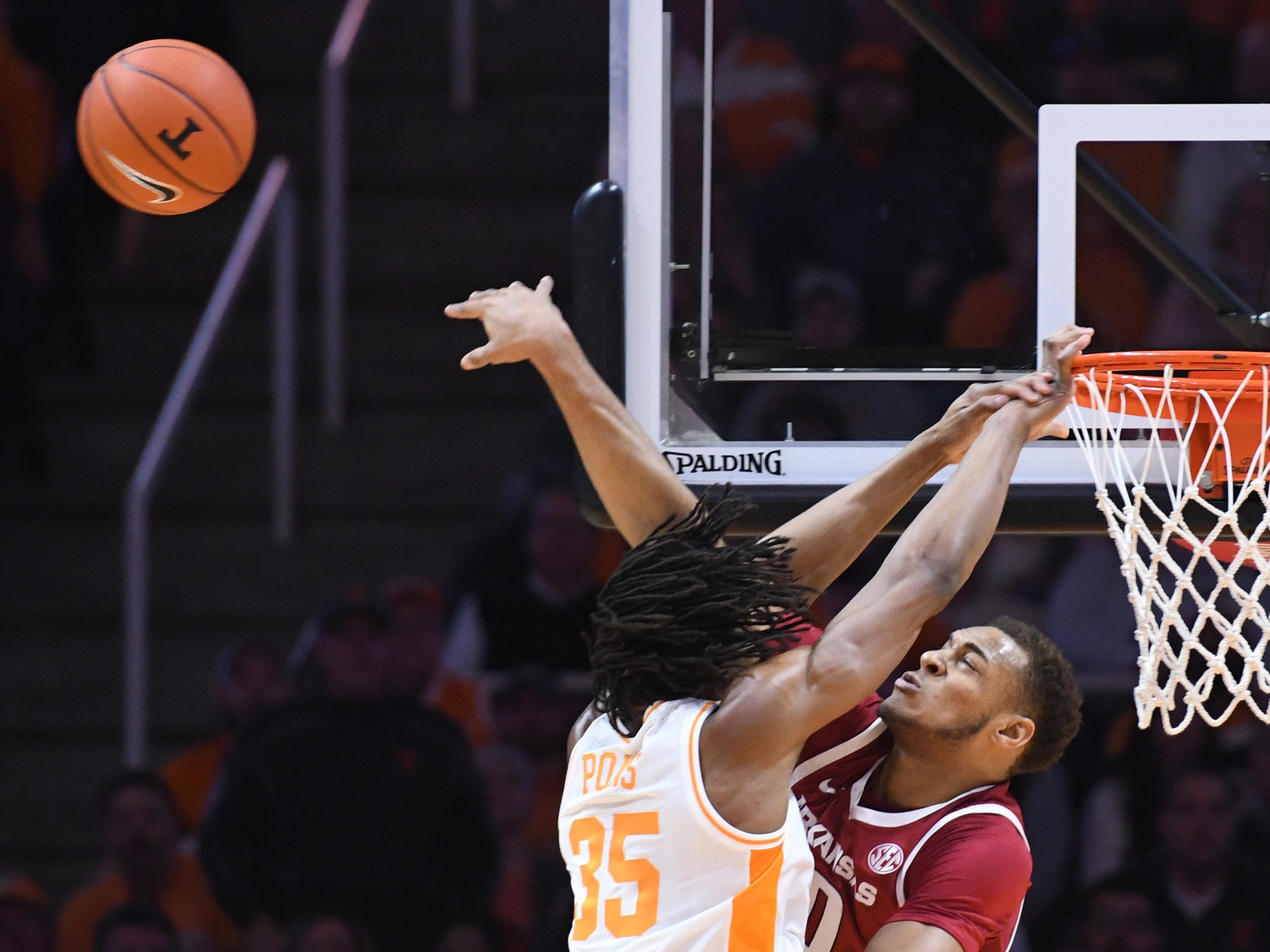 Arkansas Razorbacks forward Daniel Gafford (10) blocks a shot from Tennessee Volunteers forward Yves Pons (35) during the first half at Thompson-Boling Arena.