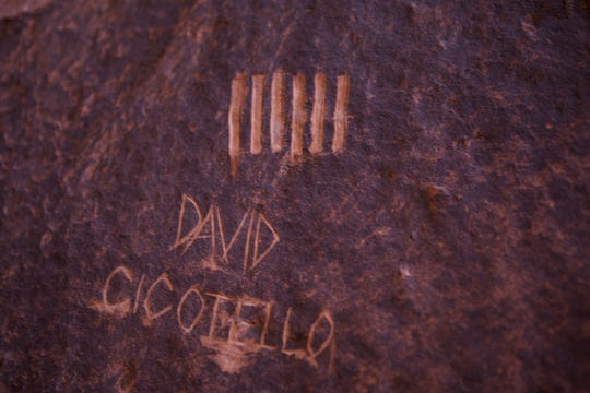 David Cicotello's carving, made about 8 feet to the left of the rappel line, marked the days that passed as he waited for rescue in No Mans Canyon, Utah. Steven D. Kugath, a faculty member in the Recreation Management Program at Brigham Young University Idaho, found them on a canyoneering trip.