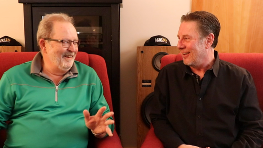 Steve Bogard, left, talks with Bart Herbison about songwriting.