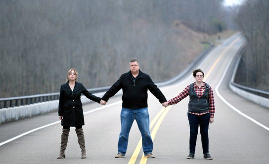 Trish Merelo, Steven Hinesley, and Sarah Elmer stand together on the Natchez Trace Bridge. Each has a family member that jumped to their death from the bridge, and they've formed the Natchez Trace Bridge Barrier Coalition in the hopes of preventing more deaths there.