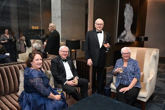 Barbara and Joel Warren, left, Al and Mary Robinson