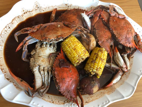 A pound (but felt like more) of blue crabs with a peppery Creole broth at Drop the Anchor seafood restaurant in North Naples.