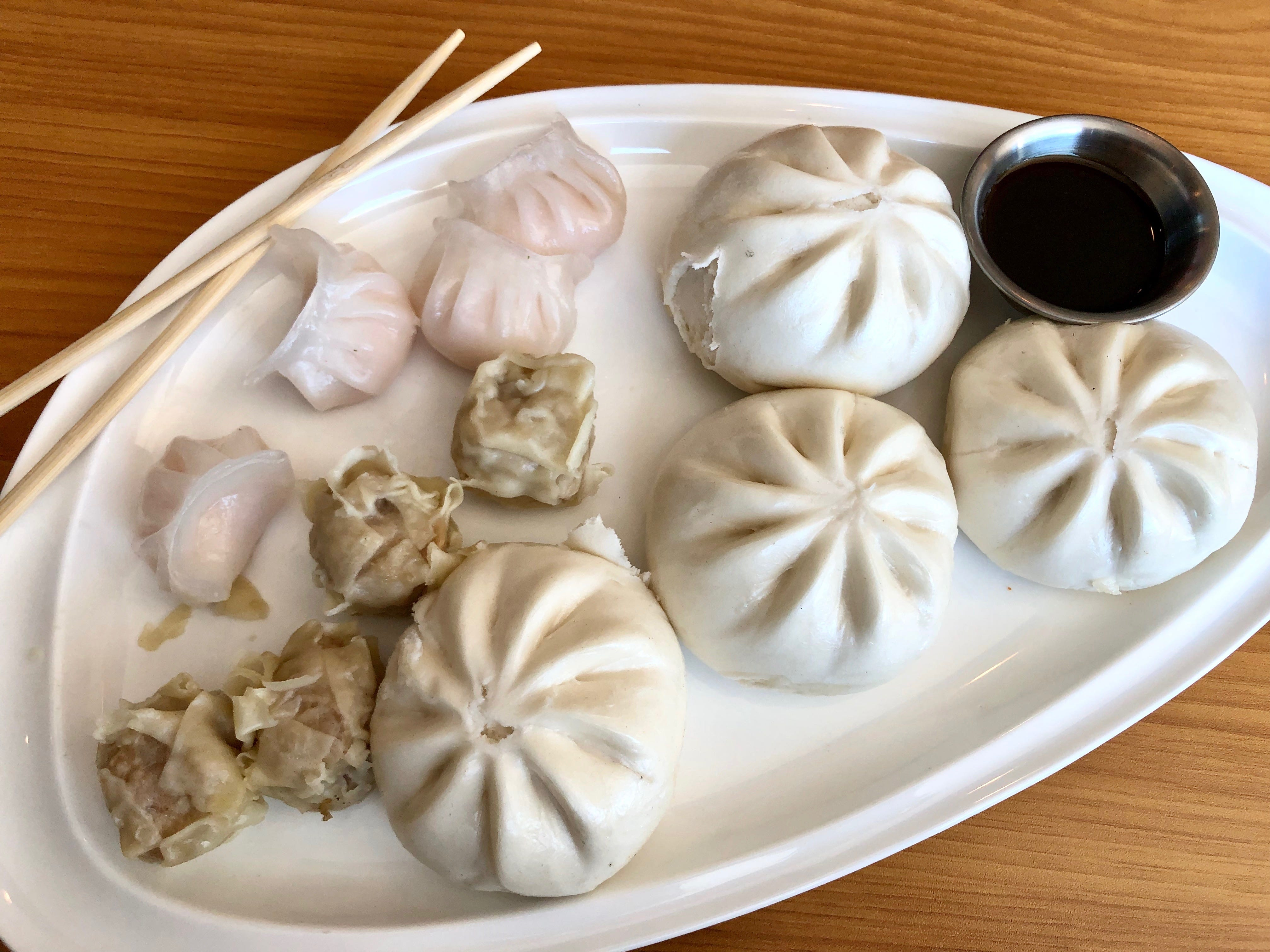 A combo plate of dim sum, with crystal shrimp dumplings, pork dumplings and barbecue pork buns, at Drop the Anchor seafood restaurant in North Naples.