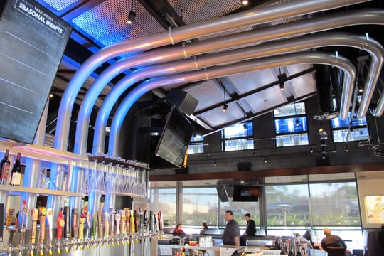 Miles of beer lines connect chilled kegs on the second floor to taps at the Yard House bar at Park Shore Plaza in Naples.