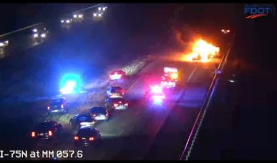 A vehicle (or vehicles) appears to be in flames on I-75.