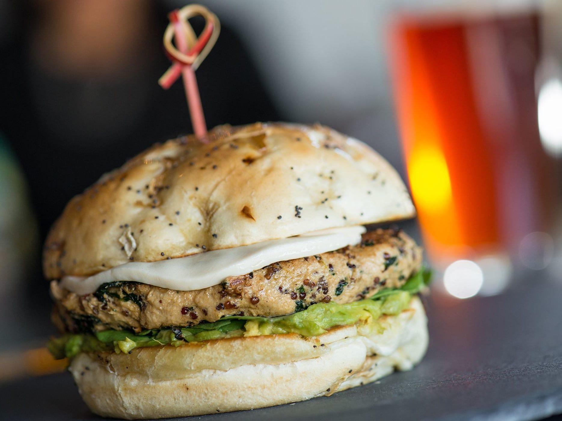 The vegan burger at Yard House is based on a blend of red quinoa, kale and shiitake mushrooms garnished with Daiya vegan mozzarella, avocado, tomato, arugula, onion and miso on an onion bun.