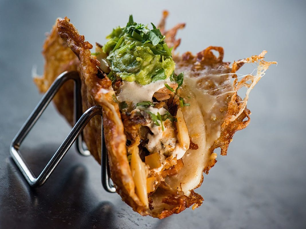 """Yard House's """"Vampira-Style"""" tacos feature street tacos wrapped in a grilled, crispy cheese-crusted flour tortilla shell."""