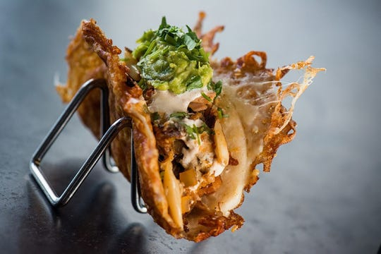 "Yard House's ""Vampira-Style"" tacos feature street tacos wrapped in a grilled, crispy cheese-crusted flour tortilla shell."