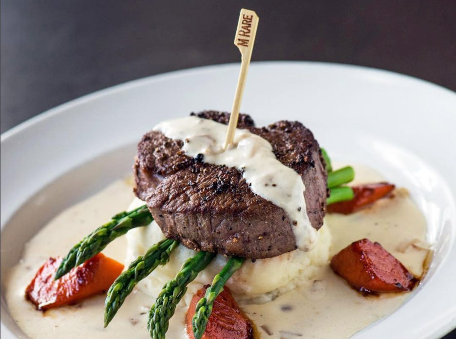 Yard House's Pepper Crusted Filet features a 7.5-ounce steak with Parmesan mashed potatoes, asparagus and carrots with brandy shallot cream sauce.