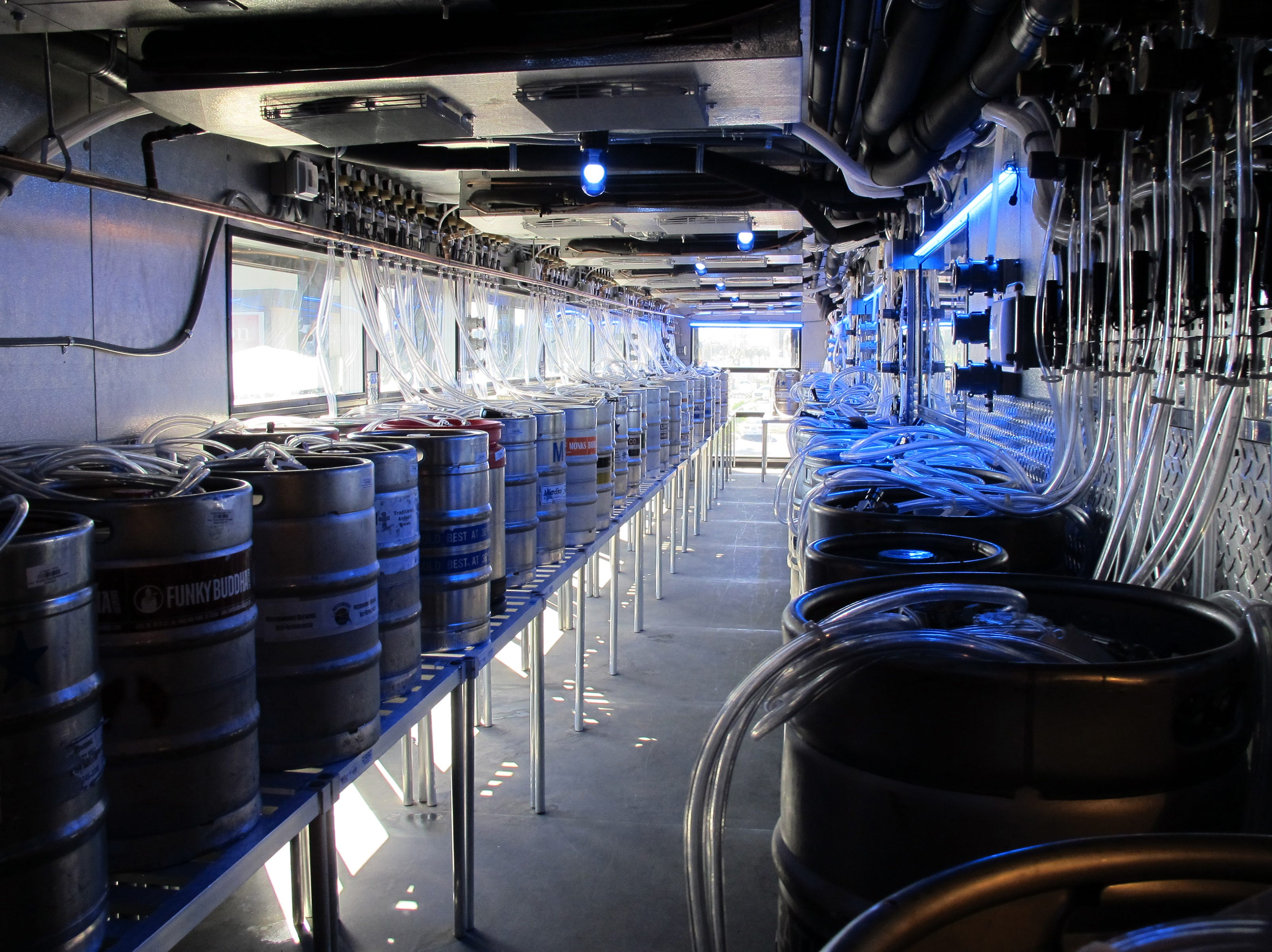Chilled kegs on the second floor of the new Yard House in Naples are connected to taps at the restaurant's bar by miles of beer lines.