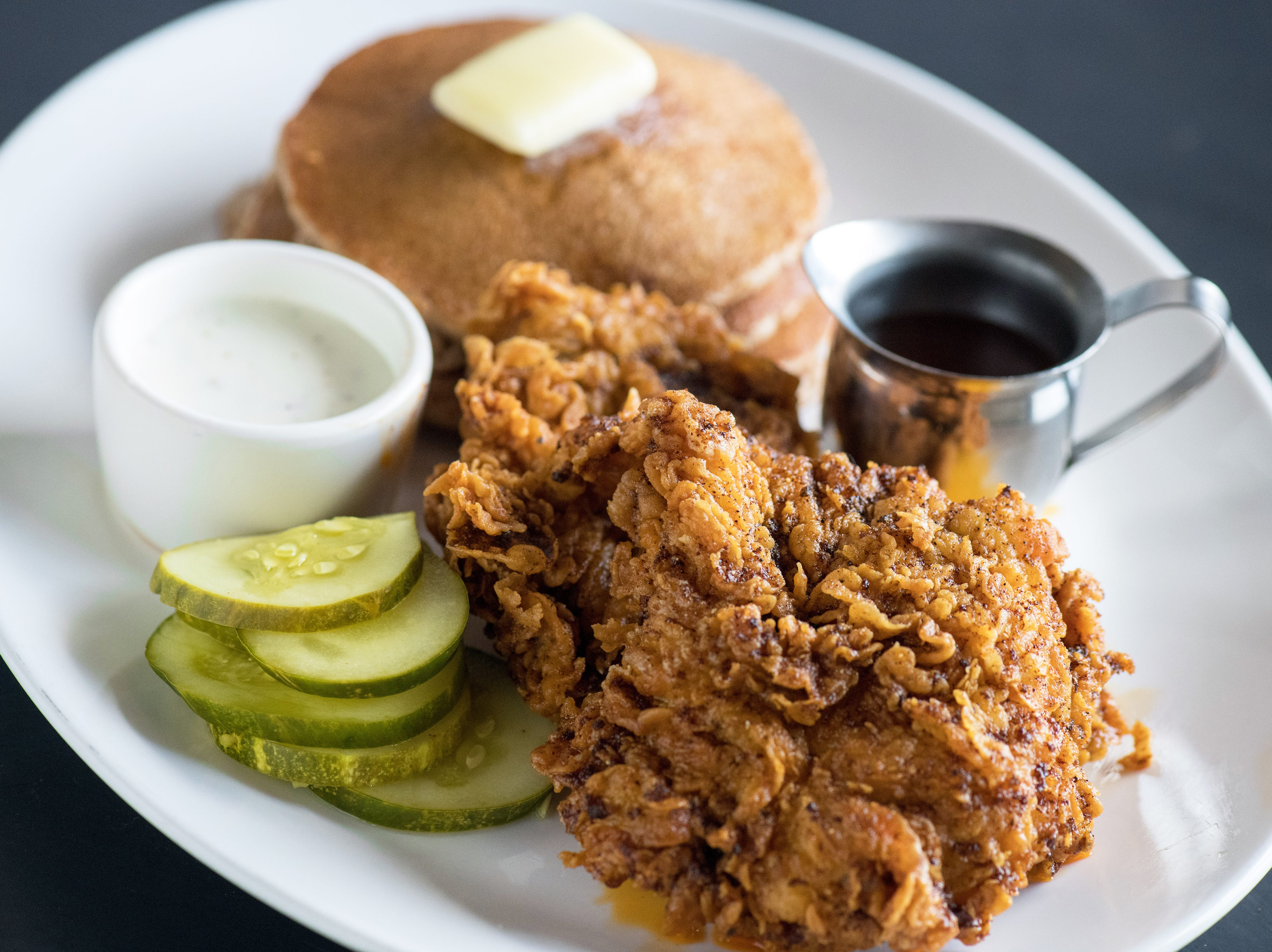 Yard House's Nashville Hot Chicken features all white meat, spicy sweet slaw and aged white cheddar spread.