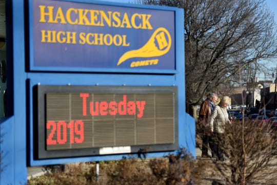 Voters leave their polling location at Hackensack High School after voting in a special election on a $170 million referendum to repair schools and build a new junior high school on the campus of Hackensack High School on Tuesday, January 22, 2019.