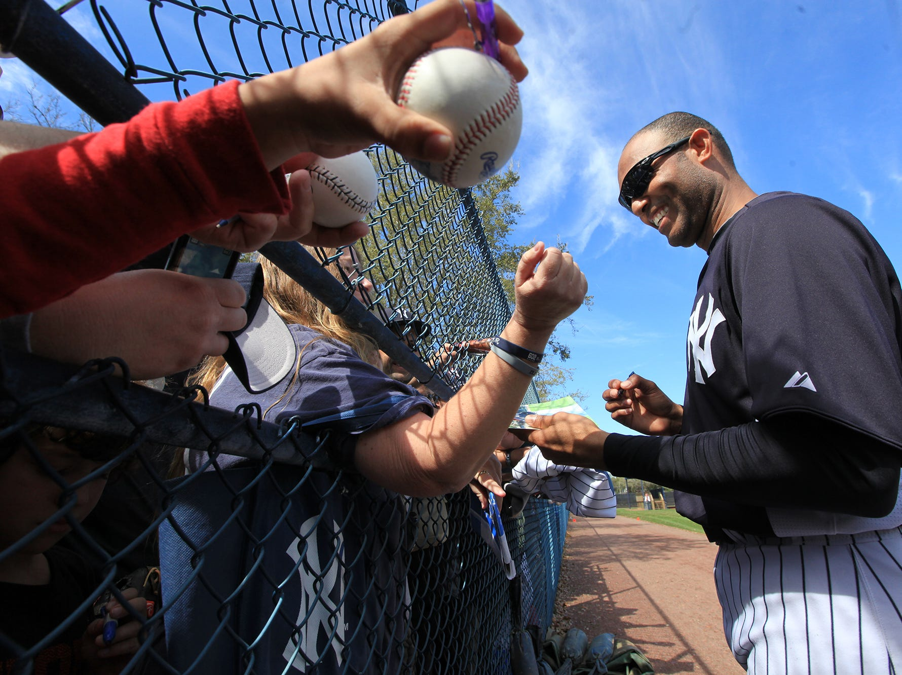 NY Yankees Spring Training 2012 -- First day workout for pitchers and catchers.  Yankee relief pitcher Mariano Rivera signs autographs for fans at the end of practice.