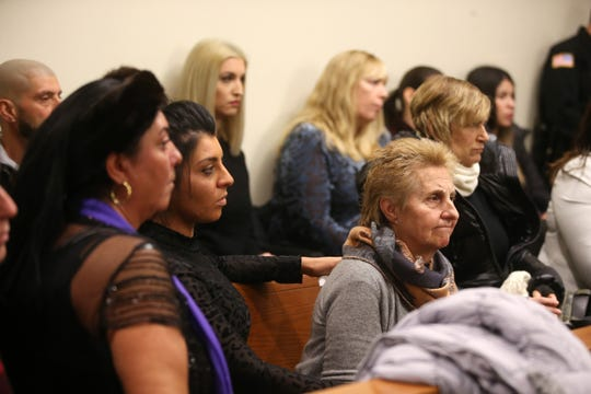 Angela Cimino, mother of Giorgina Cimino Nigro, listens with the support of her family as Vito Nigro of Woodbridge, who faces 27 years in prison for killing his ex-wife Giorgina Cimino Nigro in the home they still shared in 2015 and pleaded guilty to aggravated manslaughter in December, appears for his sentencing before Judge Colleen M. Flynn at Middlesex County Courthouse in New Brunswick, NJ Tuesday January 22, 2019.