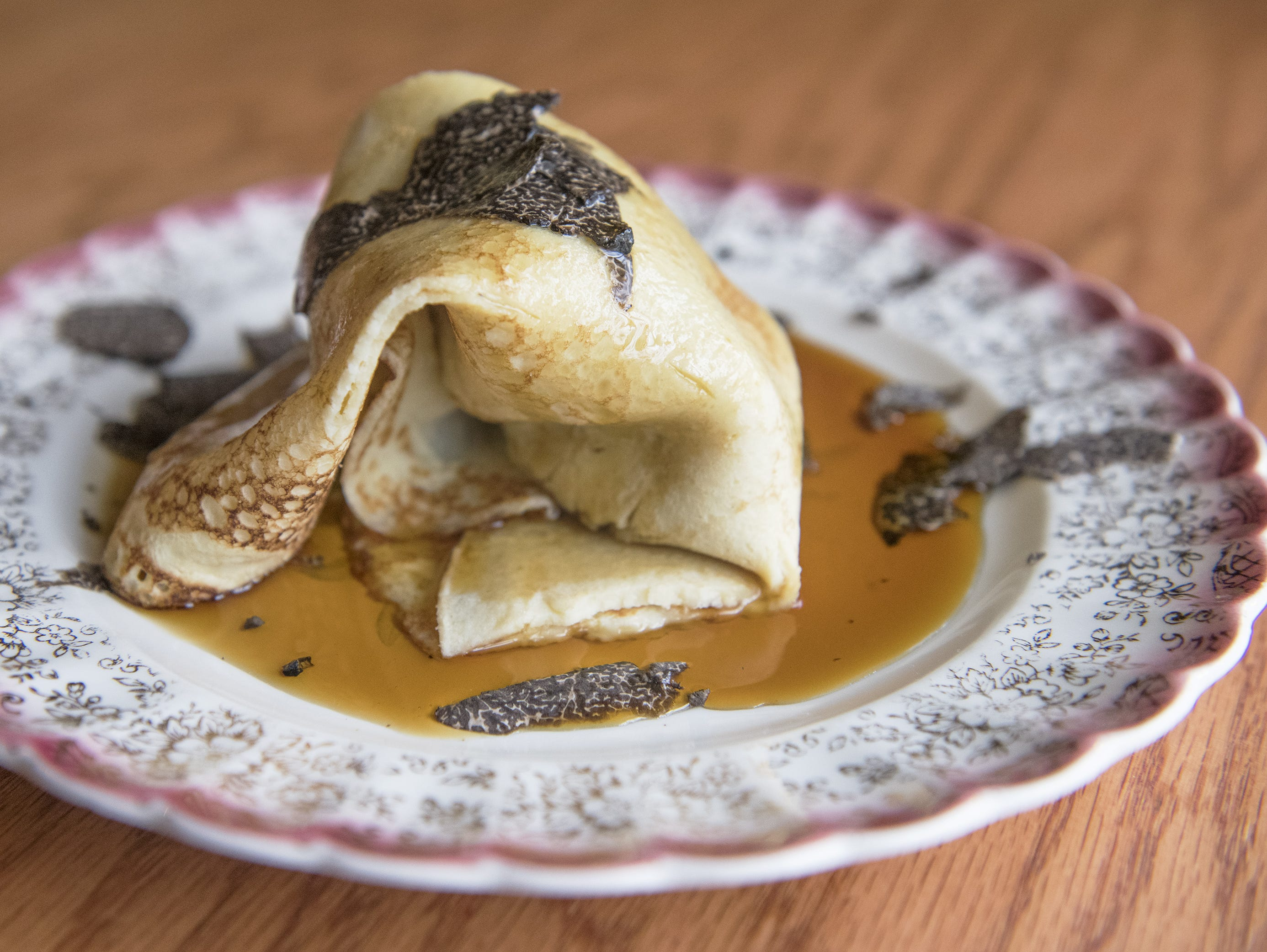 French rolled crepe with foie gras, New Jersey red maple syrup, and Perigord winter truffles is displayed at Park Place Cafe & Restaurant in Merchantville,