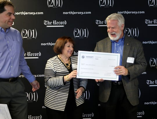 Carol Walsh and Richard Jarocki of Meals with a Mission, are excited to accept a $5,000 Gannett Foundation grant, as Dan Sforza, Editor, of The Record, is shown on the left.  Meals with a Mission plans to serve their one millionth meal on Wednesday. Tuesday, January 22, 2019