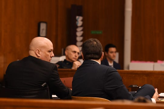 Opening arguments in the trial of Arthur Lomando at the Bergen County Courthouse in Hackensack on Tuesday, January 22, 2019. Lomando, a former New York City police officer, is accused of murdering his ex-girlfriend with a machete. (left) Lomando talks with his attorney Anthony LaPinta.