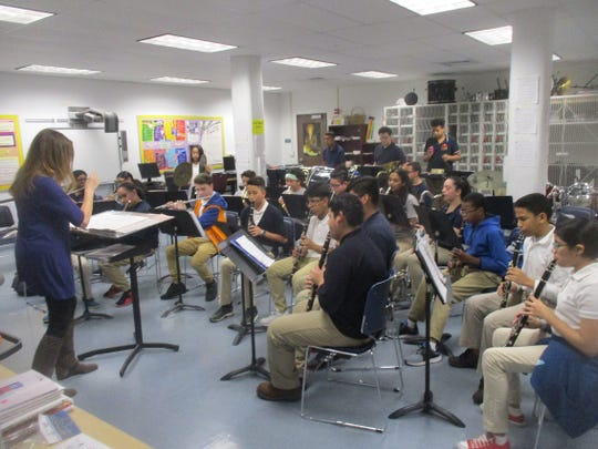 The Paterson School of Fine and Performing Arts Band, led by Director Nancy Horowitz, at a recent practice.