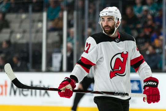 Dec 10, 2018; San Jose, CA, USA; New Jersey Devils right wing Kyle Palmieri (21) sakes during a break in the game against the San Jose Sharks in the first period at SAP Center at San Jose.