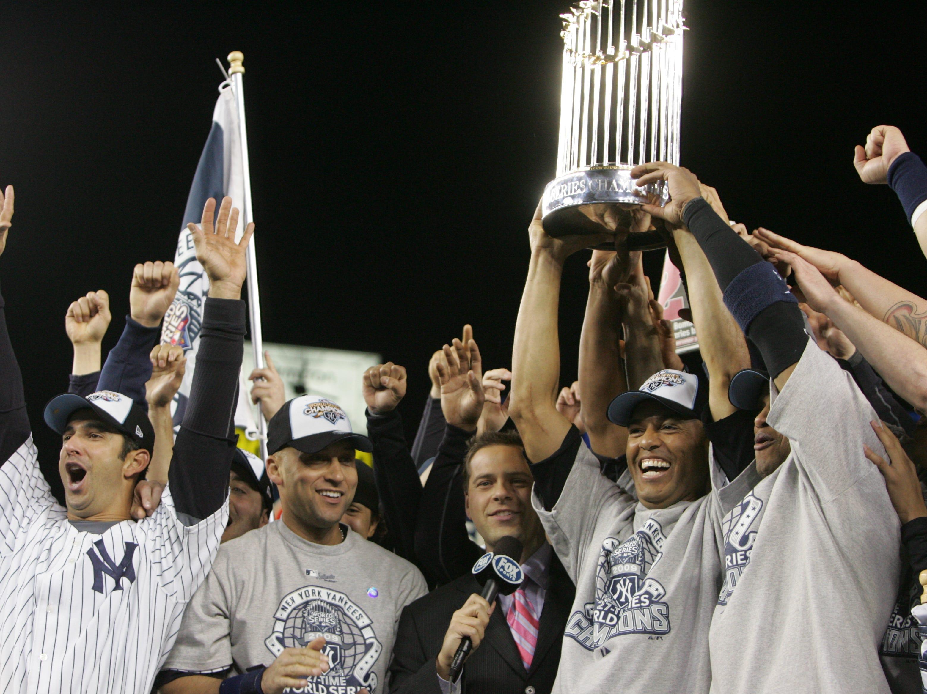 Yankees celebrate their World Series Championship. Jorge Posada, Derek Jeter and Mariano Rivera during the trophy presentation.