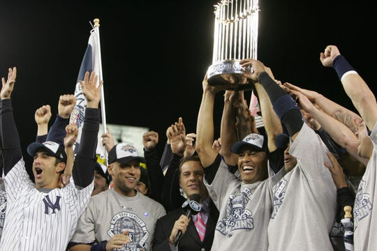 Yankees celebrate their World Series Championship. Jorge Posada, Derek Jeter and Mariano Rivera during the trophy presentation.