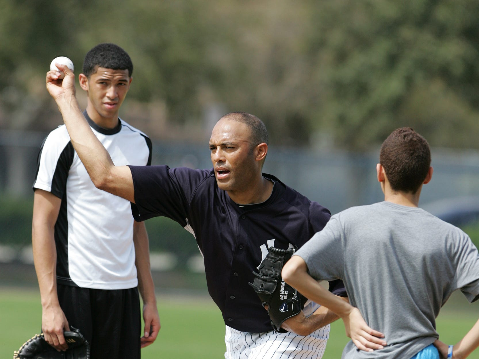 Yankees third full team workout for Spring Training at George M. Steinbrenner Field.   Mariano Rivera and his sons, Mariano Jr. and Jafet on the practice field as he gives his son, Mariano Jr. 16 pitching instructions after the Yankee workout.