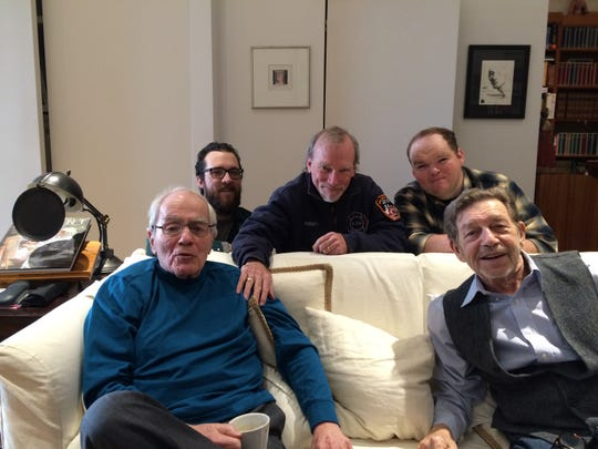 "Steve McCarthy, center, one of the three producers of ""Breslin & Hamill: Deadline Artists,"" with Jimmy Breslin, left foreground and Pete Hamill, right foreground. McCarthy's sons Justin and Ryan are on either side of him."