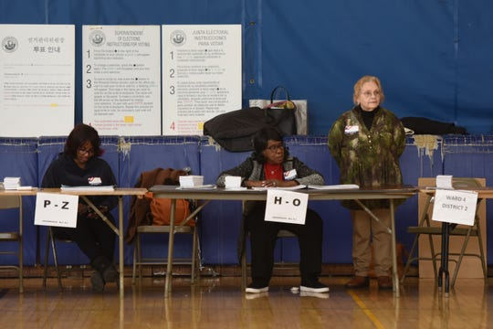 Hackensack held a special election on a $170 million referendum to repair schools and build a new junior high school on the campus of Hackensack High School on Tuesday, January 22, 2019. Poll workers wait for voters at a polling location in the gym at Hackensack High School.