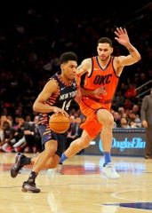 New York Knicks guard Allonzo Trier (14) dribbles the ball against Oklahoma City Thunder forward Abdel Nader (11) during the second half at Madison Square Garden.